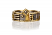 Custom Gold Band with 5 Melee Brilliant and 1 Rustic Diamonds